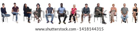 group of mixed people sitting on white Royalty-Free Stock Photo #1418144315
