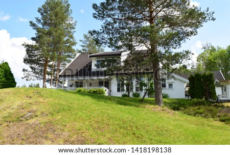 Modern white house exterior and facade with green rural trees and garden environment in sunny and summer season - beautiful scenery - Norway #1418198138