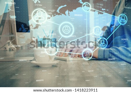 Social network theme hologram with businessman working on computer on background. Multi exposure. #1418223911