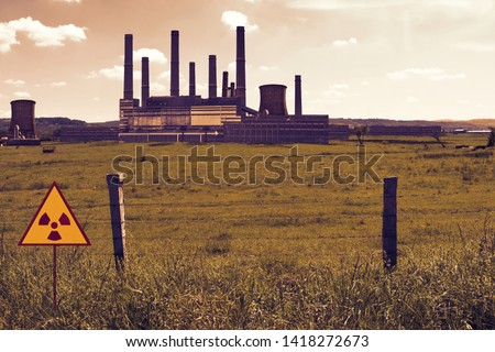 Barbed wire fence and radioactive sign on the nuclear chemical power plant's field in Chernobyl Pripyat atmosphere. Exclusion restricted area in a scary scene. Dramatic color  view #1418272673