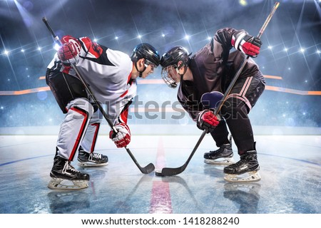 Hockey players starts game. around Ice rink arena  #1418288240