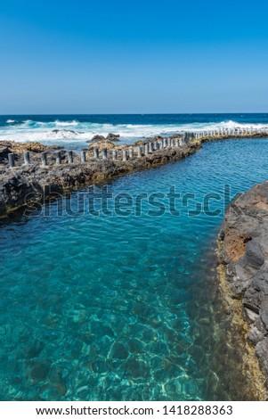 Natural pool Las Salinas de Agaete in Puerto de Las Nieves, Gran Canaria, Spain. Copy space for text. Vertical                                             #1418288363