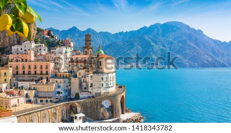 Small town Atrani on Amalfi Coast in province of Salerno, Campania region, Italy. Amalfi coast is popular travel and holyday destination in Italy. Ripe yellow lemons in foreground. #1418343782