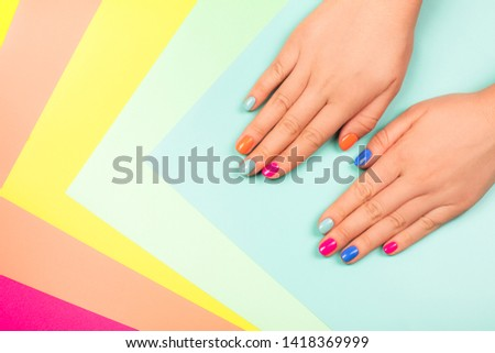 Neon manicure on multicolored bright background in trendy colors. Flat lay style. #1418369999