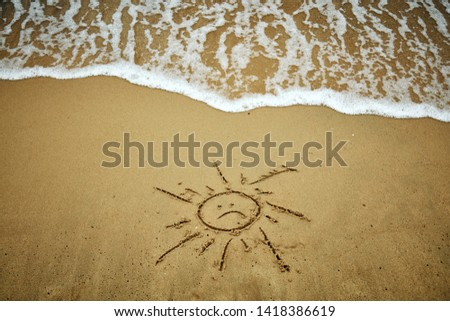 Sad symbol of sun in the sand - summertime is over. #1418386619