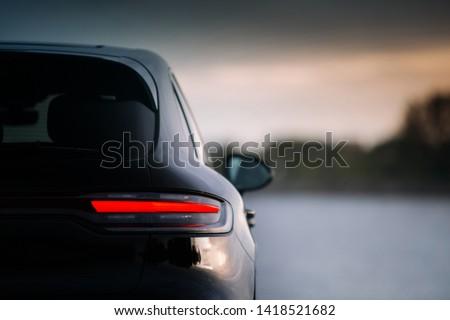 Modern suv car rear taillamp at evening #1418521682