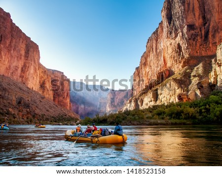 Rafting on The Colorado River in the Gran Canyon at sunrise Royalty-Free Stock Photo #1418523158