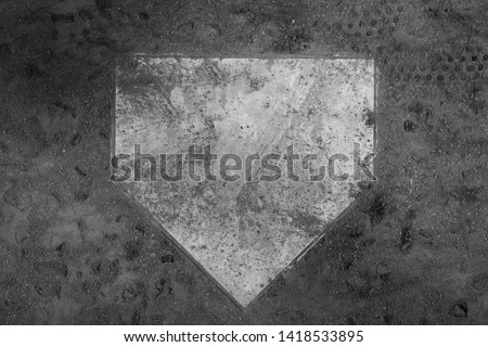 Top down view on home plate on a dirt baseball field, in a black and white sports background