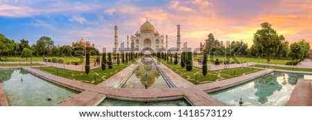 Taj Mahal Agra panoramic view at sunrise. Taj Mahal is a UNESCO World Heritage site at Uttar Pradesh India. Royalty-Free Stock Photo #1418573129