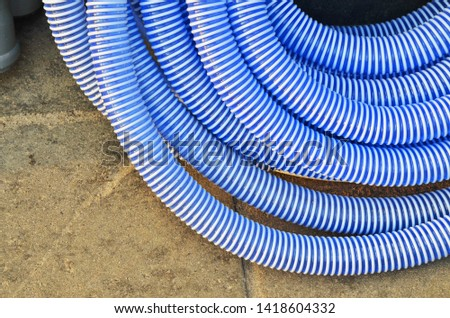 Reinforced hose for a water supply system and watering. Symbolical blue color of water. #1418604332