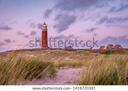 Lighthouse texel Netherlands, Dutch lighthouse Holland, red light house at the beach from above drone view #1418720381