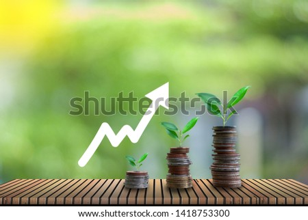 Growing crops in coins, saving - investment concepts and interest.  #1418753300
