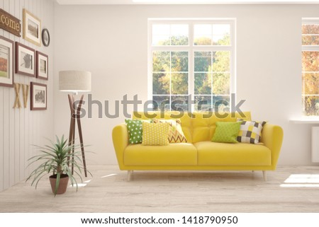 Stylish room in white color with sofa and autumn landscape in window. Scandinavian interior design. 3D illustration #1418790950