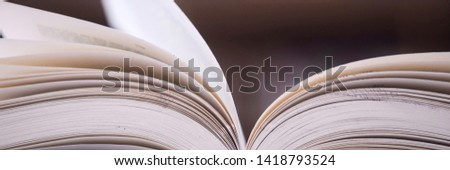 Stack of books in the library and blur bookshelf background #1418793524
