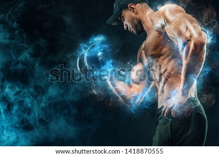 Muscular fitness sports man, atlete with dumbbell in fitness gym. Energy and power. Royalty-Free Stock Photo #1418870555