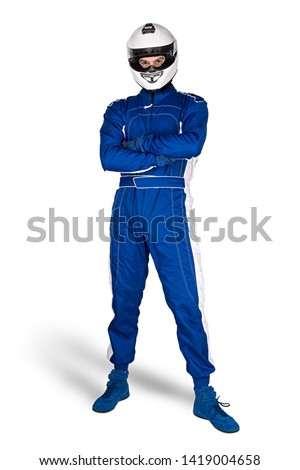 Determined race driver in blue white motorsport overall shoes gloves and integral safety crash helmet isolated on white background. Car racing motorcycle sport concept. #1419004658