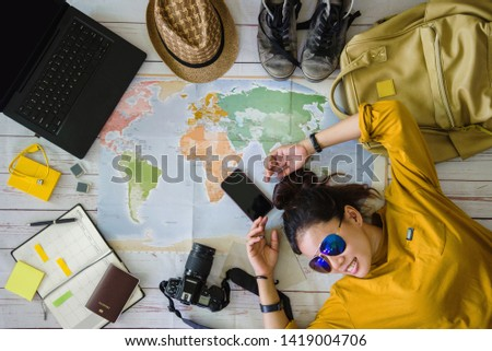 Travel planning concept with map. Overhead view of equipment for travelers. Background travel ideas young women sleeping smiling on the map. concept on vacation trip, map, Travel Thailand. #1419004706