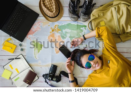 Travel planning concept with map. Overhead view of equipment for travelers. Background travel ideas young women sleeping smiling on the map. concept on vacation trip, map, Travel Thailand. #1419004709