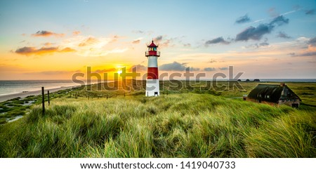 Sunrise at lighthouse in List on the island of Sylt, Schleswig-Holstein, Germany #1419040733