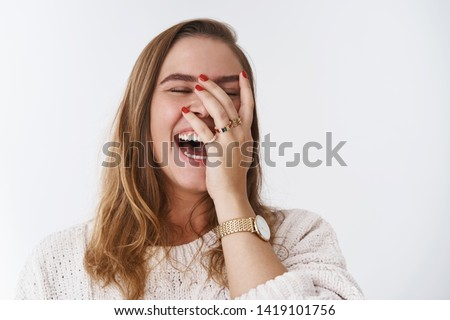 Charismatic carefree joyful friendly-looking outgoing woman likes laugh out loud not hiding emotions giggling hear funny hilarious joke chuckling facepalm close eyes smiling broadly white background #1419101756