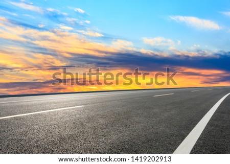 Asphalt road and sunset sky #1419202913