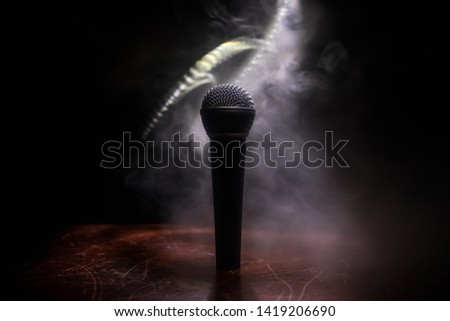 Microphone for sound, music, karaoke in audio studio or stage. Mic technology. Voice, concert entertainment background. Speech broadcast equipment. Live pop, rock musical performance #1419206690
