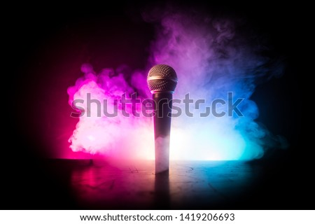 Microphone for sound, music, karaoke in audio studio or stage. Mic technology. Voice, concert entertainment background. Speech broadcast equipment. Live pop, rock musical performance #1419206693