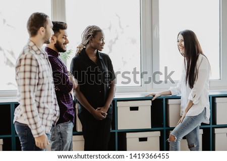 Group of business people discussing work in office building hallway #1419366455