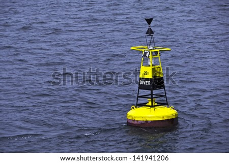 Ocean buoy; diver buoy; black and yellow; excellent copy-space  Royalty-Free Stock Photo #141941206