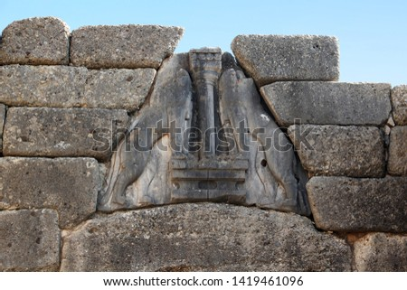MYCENAE, GREECE - SEPTEMBER 20, 2012: This is the relief with lions on the Lion Gate, which is the entrance to the acropolis of the ancient city of the second millennium BC. #1419461096