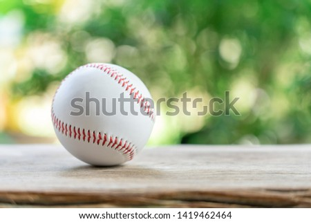 baseball on Abstract background and red stitching baseball. White baseball with red thread.Baseball is a national sport of Japan. It is popular. #1419462464