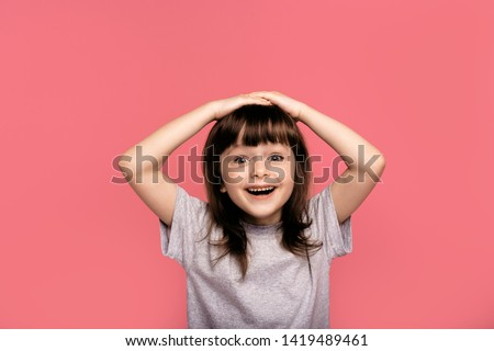 Portrait of funky cute astonished surprised child kid little girl touch hand head shout yell wonder hear incredible information bargain impressed dressed grey clothing isolated pink background #1419489461