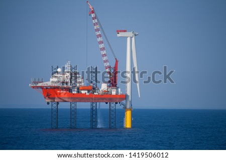 Offshore Wind Turbine in a Windfarm under construction  off the English Coast, North Sea Royalty-Free Stock Photo #1419506012