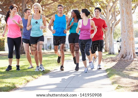 Group Of Runners On Suburban Street #141950908