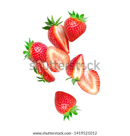 The composition of strawberries on white background. Cut strawberries into pieces with copy space. Fresh natural strawberry isolated. Strawberry slices flying in the air #1419521012