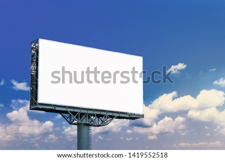 Blank billboard mockup with white screen against clouds and blue sky background. Copy space banner for advertisement. Business Concept.  #1419552518