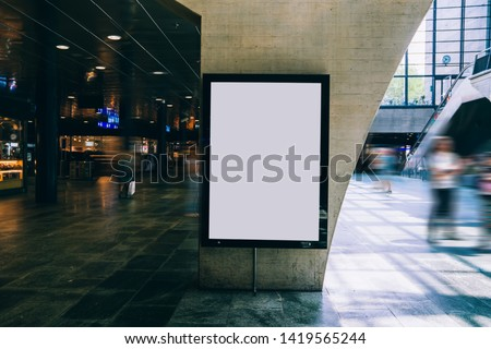 Clear Billboard in public place with blank copy space screen for advertising or promotional poster content, empty mock up Lightbox for information, blank display in station area with daylight #1419565244