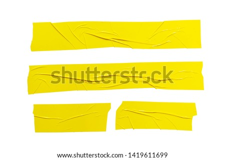 Set of  different size yellow adhesive sticky tapes. Torn crumpled sellotape pieces collection isolated on white background Royalty-Free Stock Photo #1419611699