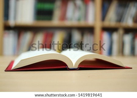 Open book on table in library #1419819641