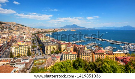 Panoramic view of Naples city, Chiaia neighborhood, Mount Vesuvius and gulf of Napoli, Mediterranean sea, Italy #1419851036