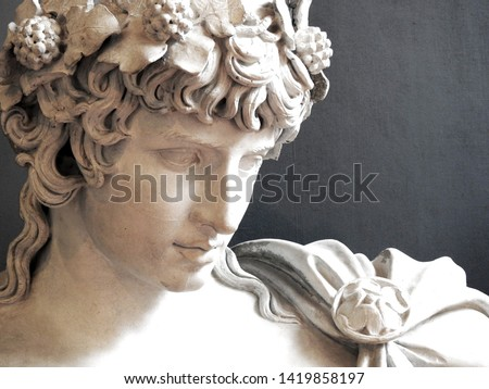 Close up of Ancient Greek Roman sculpture of Antinous dressed as god of wine Dionysus lover of Emperor Hadrian Royalty-Free Stock Photo #1419858197