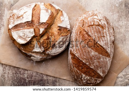 Bread background, top view of, black and rye loaves on black. #1419859574