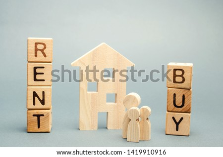 Wooden blocks with the word Rent or buy and a family stands near the house. Make the right decision. Real estate concept. Rent apartment. Property. Rental, renting home. Buying. Purchase housing #1419910916