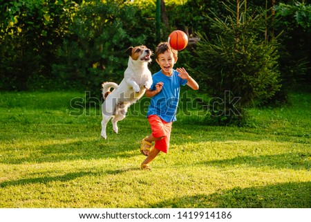Family having fun outdoor with dog and basketball ball #1419914186