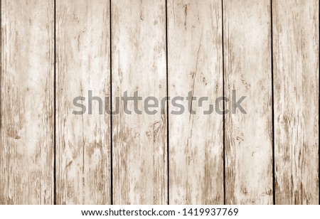 Weathered wooden fence in brown color. Abstract background and texture for design. #1419937769