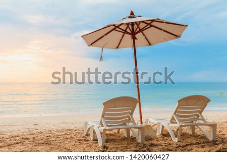 Beach chairs with a white umbrella with blue sky on tropical beach.Beautiful, the beach in summer. Thailand.  #1420060427