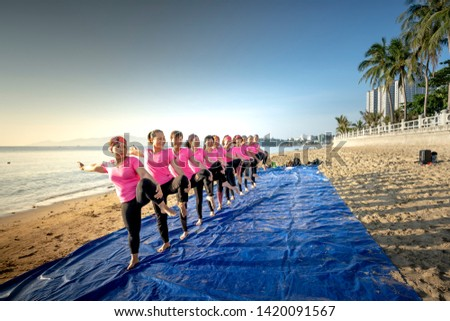 Nha Trang City, Vietnam - May 18, 2019: A training session on the beach at the dawn of a yoga club in Nha Trang City, Khanh Hoa Province, Vietnam #1420091567