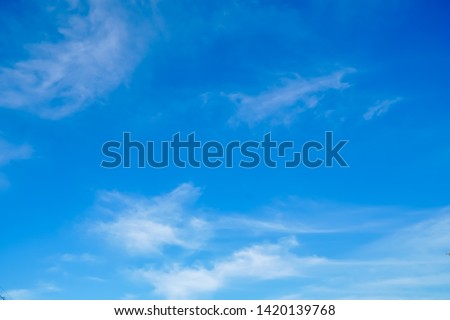 fluffy and softness white clouds floating on shade of blue sky in sunshine day #1420139768