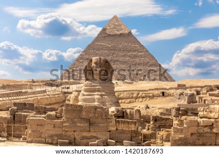 The Sphinx, the Pyramid of Chephren and the ruins of a temple in Giza, Egypt #1420187693