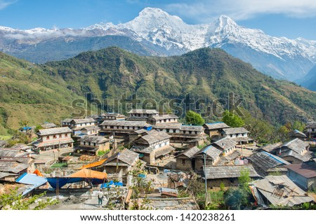 View of Annapurna range includes Annapurna South and Mt.Himchuli view from Ghandruk village in northern-central of Nepal. Ghandruk is most popular for wonderful Gurung culture in Nepal. #1420238261